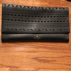 Kate spade clutch with cutouts